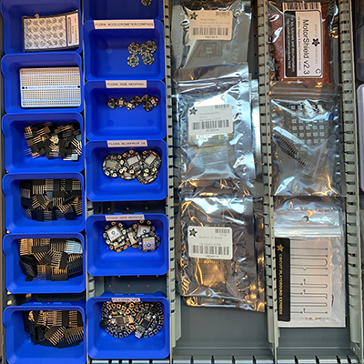 image of wearable electronics boards in drawer