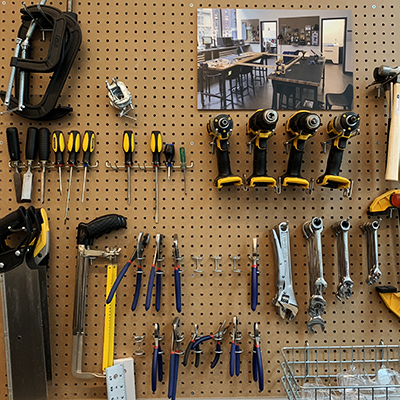 image of hand tools hanging from pegboard
