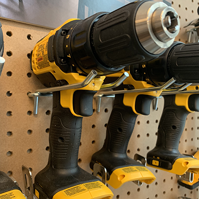 image of impact drivers hanging from pegboard